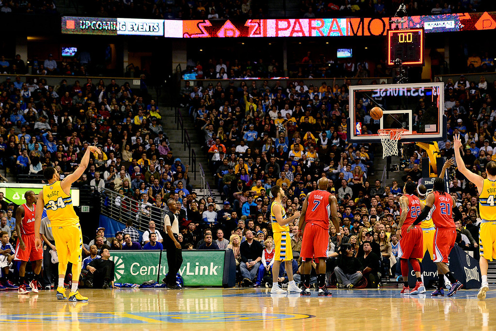Description of . Denver Nuggets center JaVale McGee (34) hits a three pointer to end the third against the Los Angeles Clippers during the second half of the Nugget's 92-78 win at the Pepsi Center on Tuesday, January 1, 2013. AAron Ontiveroz, The Denver Post