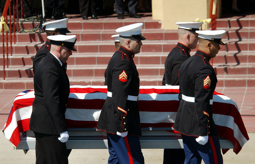 . U.S. Marines carry the body of U.S. Marine Lance Cpl. Jose Gutierrez, one of the first Americans killed in the U.S.-led Operation Iraqi Freedom March 21, into St. Margaret Mary Alacoque Catholic Church prior to his memorial mass April 7, 2003 in the Los Angeles area city of Lomita, California. Gutierrez came to the U.S. as an illegal immigrant from his native Guatemala and was posthumously made a citizen of the U.S. (Photo by David McNew/Getty Images)