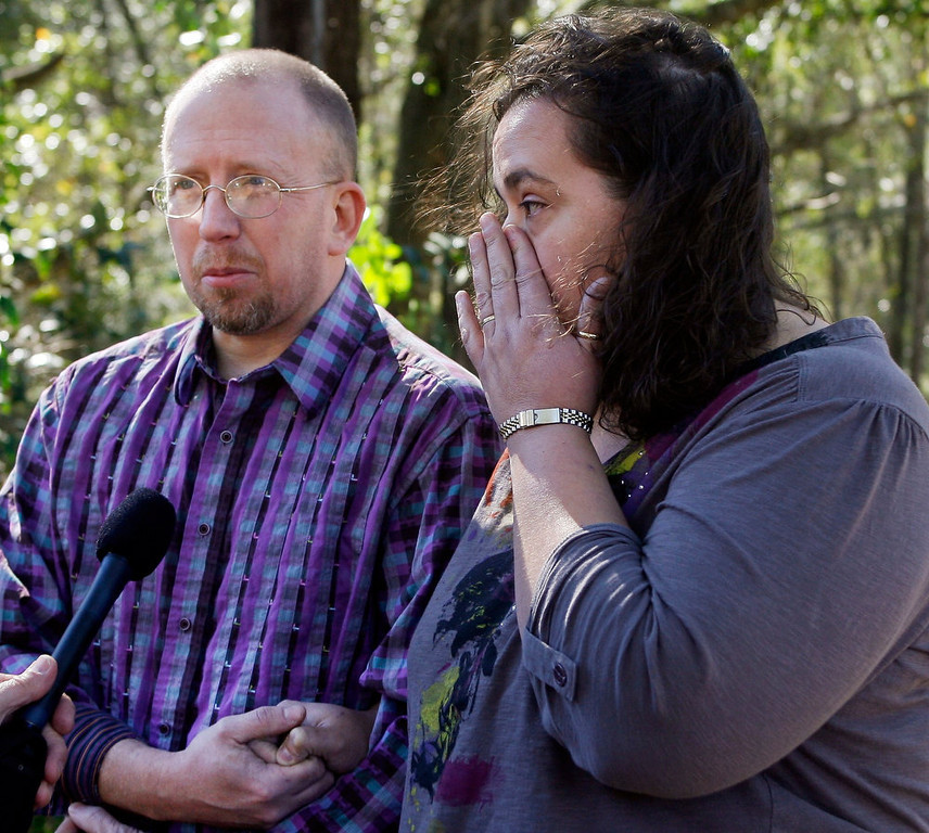 Description of . Aaron Poland and Lydia Hancock, son and daughter of murdered bus driver Charles Poland, react as they talk about him during an interview at their father's home in Newton, Alabama, January 31, 2013. Poland died January 29 at the scene of a shooting and hostage taking in nearby Midland City. The standoff stretched into a third day on Thursday with an Alabama man accused of fatally shooting a school bus driver and then taking a young boy hostage in an underground bunker equipped with electricity and food. REUTERS/Phil Sears