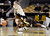 Wyoming's Chelan Landry dives for a loose ball in front of Colorado's Lexy Kresl during their NCAA college basketball game, Wednesday, Nov. 28, 2012, in Boulder, Colo. (AP Photo/The Daily Camera, Jeremy Papasso)