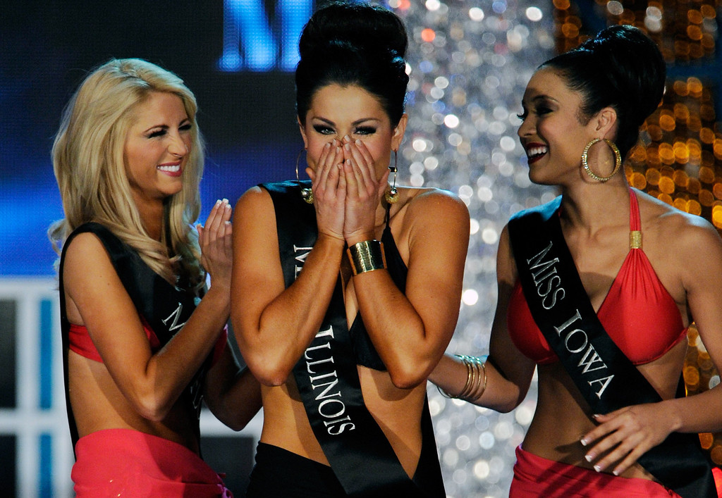 Description of . Laura McKeeman (L), Miss Florida, and Mariah Cary (R), Miss Iowa, congradulate Megan Ervin, Miss Illinois, as she reacts during the 2013 Miss America Pageant at PH Live at Planet Hollywood Resort & Casino on January 12, 2013 in Las Vegas, Nevada.  (Photo by David Becker/Getty Images)