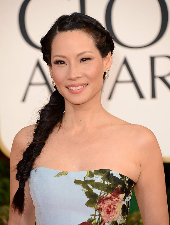 Description of . Actress Lucy Liu hit a home run with her hair and make-up, but her overall look makes her the worst dressed at the 70th Annual Golden Globe Awards.  Though we applaud her for going with such a bold look.  (Photo by Jason Merritt/Getty Images)