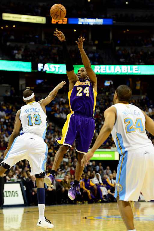 Description of . Los Angeles Lakers shooting guard Kobe Bryant (24) takes a jumper over Denver Nuggets small forward Corey Brewer (13) during the second half of the Nuggets' 126-114 win at the Pepsi Center on Wednesday, December 26, 2012. AAron Ontiveroz, The Denver Post