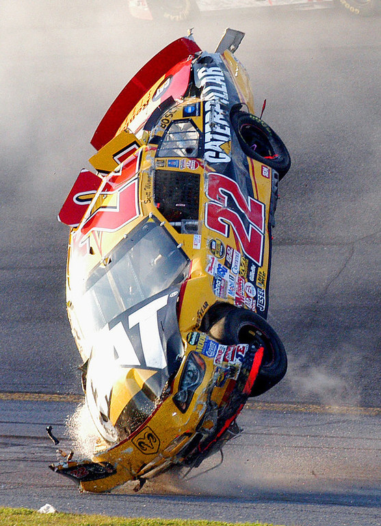 Description of . The car of NASCAR driver Scott Wimmer (22) flips through the air during a multi-car wreck in Turn 3 and 4 during the Daytona 500 at the Daytona International Speedway in Daytona Beach, Fla., on Sunday, Feb. 20, 2005. (AP Photo/Rob Sweeten)