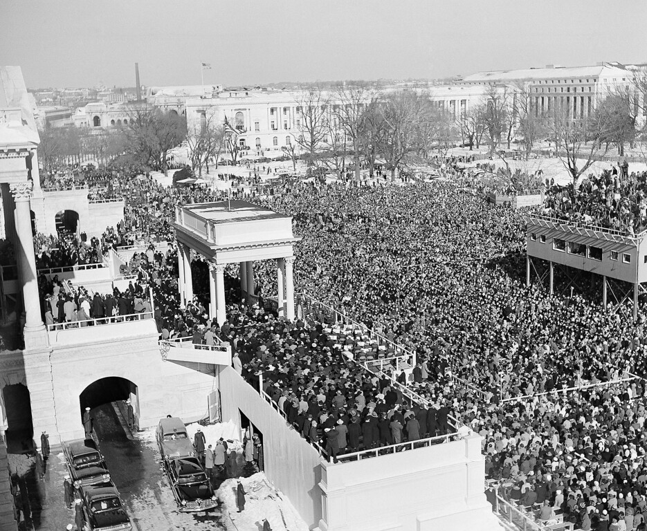 Description of . In this Jan. 20, 1961 black-and-white file photo, the crowd in Capitol Plaza gather to witness the inauguration of John F. Kennedy as President of the United States. (AP Photo)
