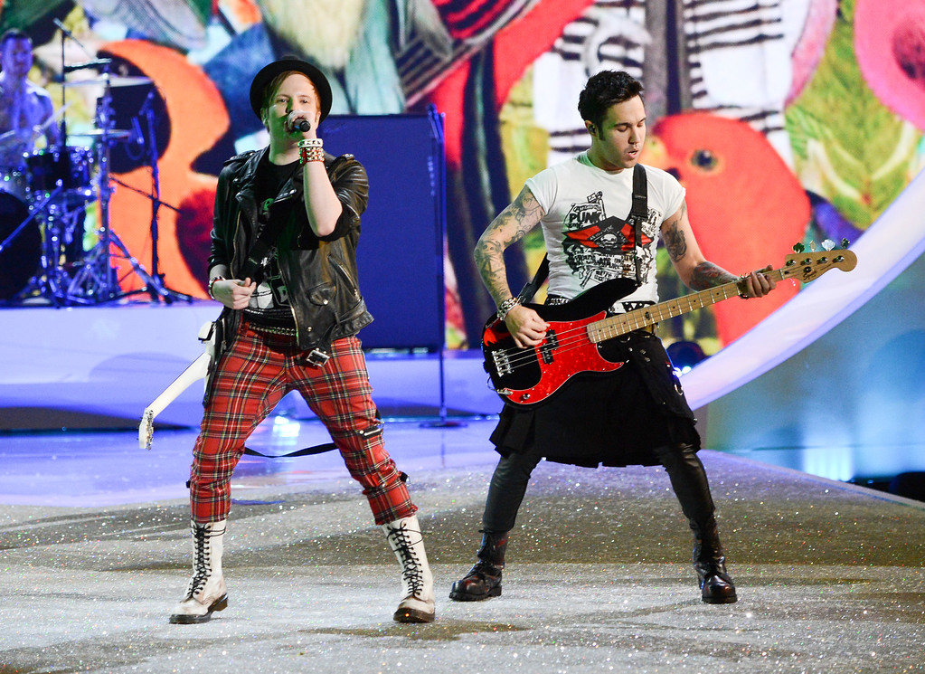 Description of . Patrick Stump and Pete Wentz of Fall Out Boy perform during the 2013 Victoria's Secret Fashion Show at the 69th Regiment Armory on Wednesday, Nov. 13, 2013 in New York. (Photo by Evan Agostini/Invision/AP)