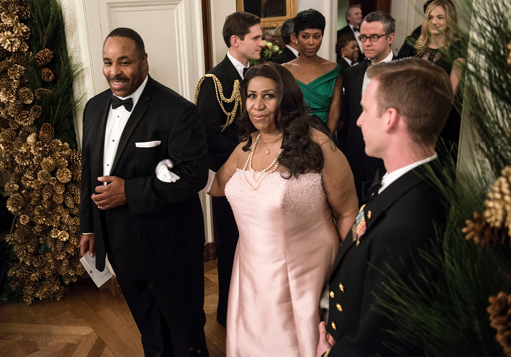 Description of . Singer Aretha Franklin arrives for an event in the East Room of the White House December 2, 2012 in Washington, DC.  US President Barack Obama and First Lady Michelle Obama attended the event at the White House with the 2012 Kennedy Center Honorees to celebrate their contribution to the arts before heading to the Kennedy Center for the honors program.    BRENDAN SMIALOWSKI/AFP/Getty Images