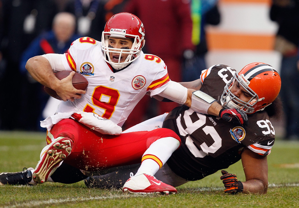 Description of . CLEVELAND, OH - DECEMBER 09:  Quarterback Brady Quinn #9 of the Kansas City Chiefs is sacked by defensive lineman John Hughes #93 of the Cleveland Browns at Cleveland Browns Stadium on December 9, 2012 in Cleveland, Ohio.  (Photo by Matt Sullivan/Getty Images)
