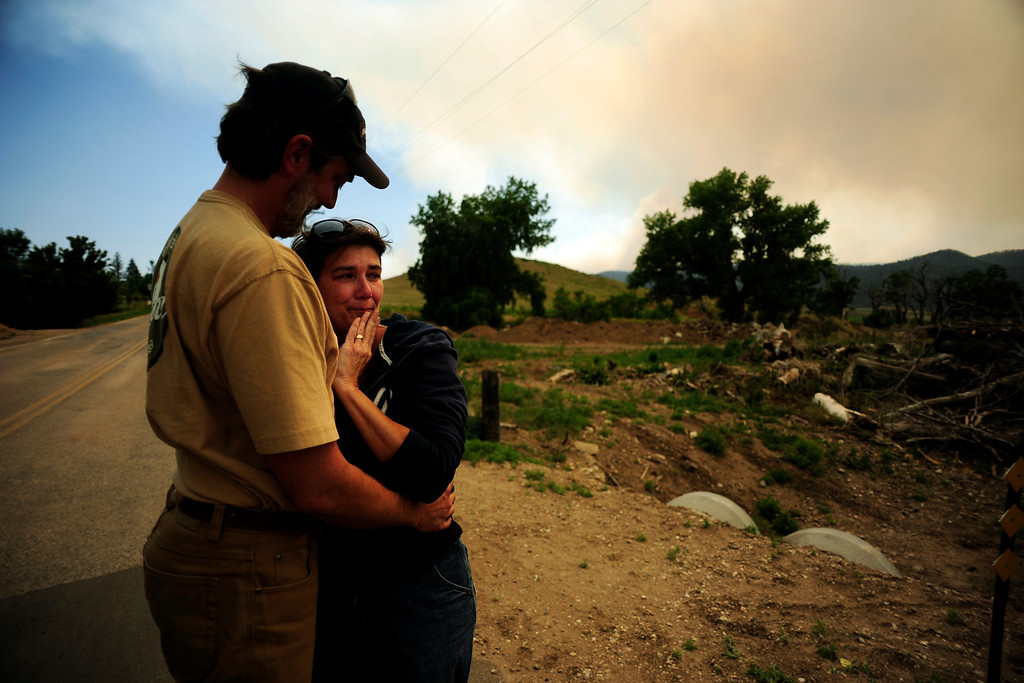 Description of . Pat and Lori Tovaas hug upon finding that their trailer had not burned down in Rist Canyon as the High Park fire west of Fort Collins and Loveland continued to burned on Monday, June 11, 2012. The fire burned more than 35,000 acres encompassing more than 60 square miles. AAron Ontiveroz, The Denver Post