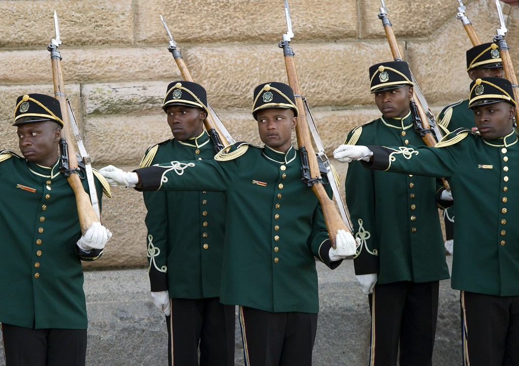 Description of . An honor guard lines up for the arrival of US President and First Lady for meetings with South African President at the Union Building in Pretoria, South Africa, on June 29, 2013. US President Barack Obama will not visit his political hero Nelson Mandela in hospital, out of deference for the anti-apartheid icon's
