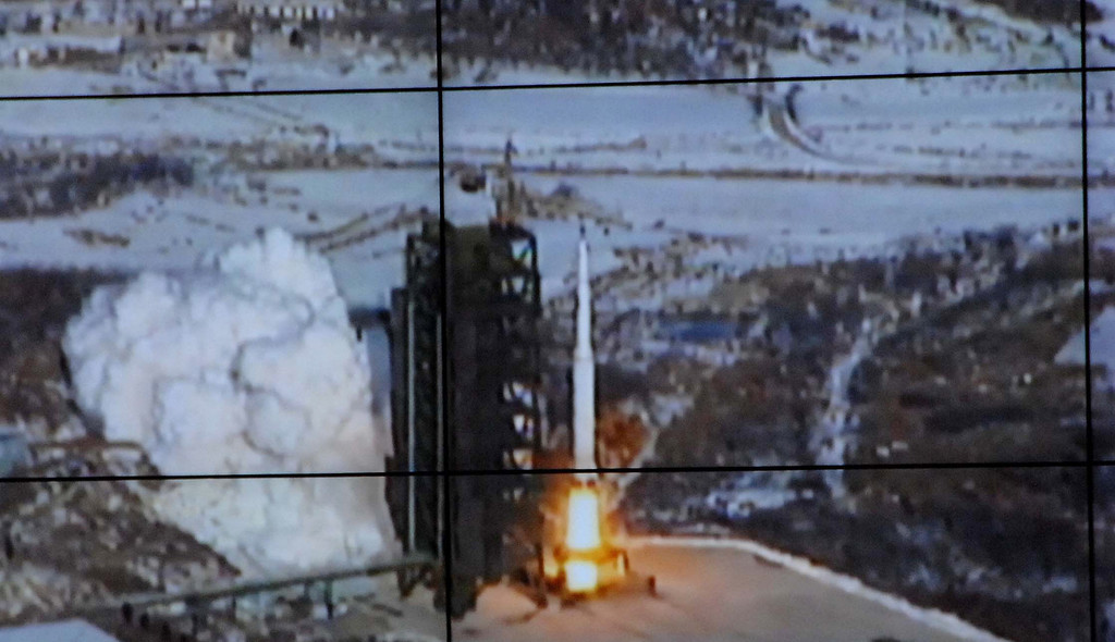 Description of . In this monitor screen image taken and released by the Korean Central News Agency and distributed in Tokyo by the Korea News Service, the Unha-3 rocket lifts off from a launch site on the west coast, in the village of Tongchang-ri, about 56 kilometers (35 miles) from the Chinese border city of Dandong, North Korea, Wednesday, Dec. 12, 2012. North Korea successfully fired a long-range rocket on Wednesday. (AP Photo/Korea Central News Agency via Korea News Service)