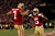 Quarterback Colin Kaepernick #7 of the San Francisco 49ers celebrates with wide receiver Michael Crabtree #15 after running the ball for a touchdown against the Green Bay Packers in the third quarter during the NFC Divisional Playoff Game at Candlestick Park on January 12, 2013 in San Francisco, California.  (Photo by Stephen Dunn/Getty Images)