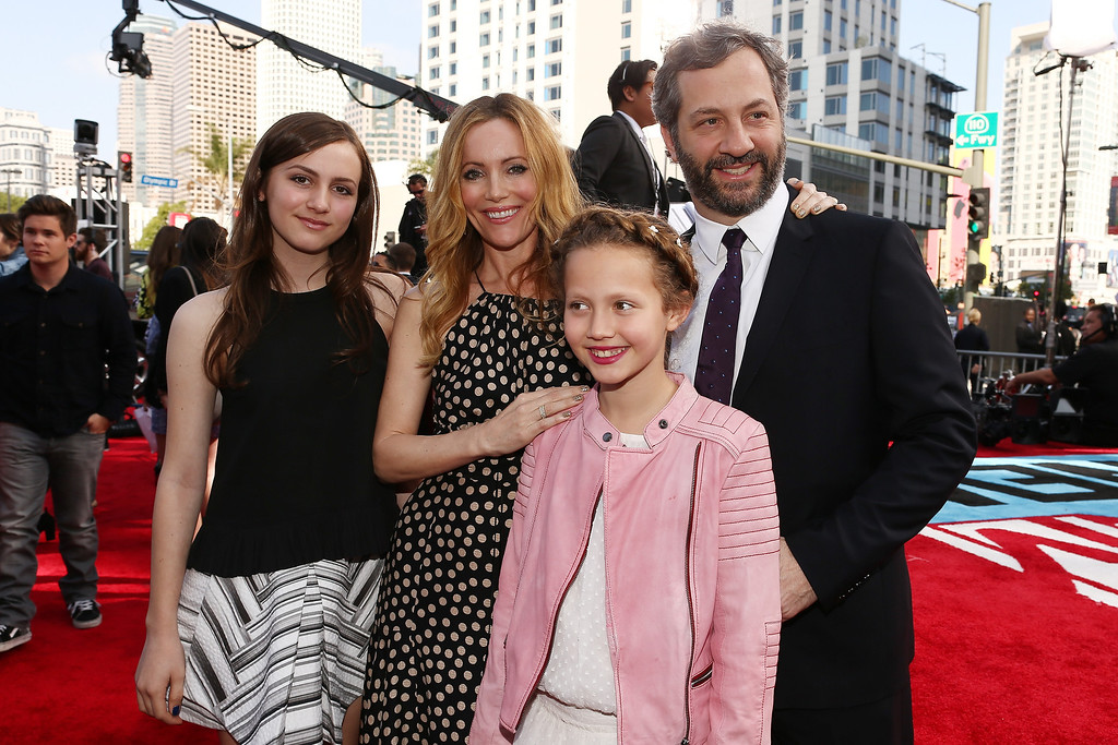 Description of . (L-R) Actresses Maude Apatow, Leslie Mann, Iris Apatow and producer/director Judd Apatow attend the 2014 MTV Movie Awards at Nokia Theatre L.A. Live on April 13, 2014 in Los Angeles, California.  (Photo by Christopher Polk/Getty Images for MTV)