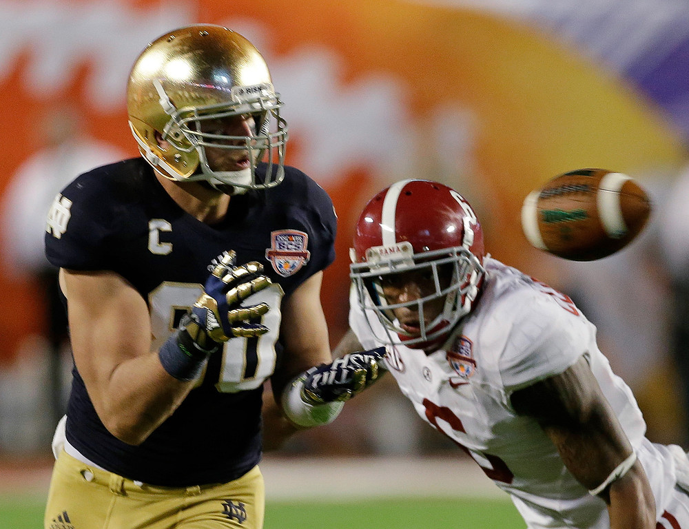 Description of . Notre Dame's Tyler Eifert (80) catches a pass in front of Alabama's Ha'Sean Clinton-Dix (6) during the second half of the BCS National Championship college football game Monday, Jan. 7, 2013, in Miami. (AP Photo/Chris O'Meara)
