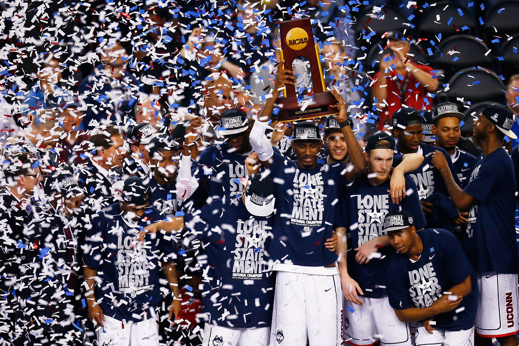 Description of . ARLINGTON, TX - APRIL 07: DeAndre Daniels #2 of the Connecticut Huskies holds up the trophy after defeating the Kentucky Wildcats 60-54 in the NCAA Men\'s Final Four Championship at AT&T Stadium on April 7, 2014 in Arlington, Texas.  (Photo by Tom Pennington/Getty Images)
