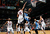 Ty Lawson #3 of the Denver Nuggets lays in a basket against Al Horford #15 of the Atlanta Hawks at Philips Arena on December 5, 2012 in Atlanta, Georgia.  (Photo by Kevin C. Cox/Getty Images)