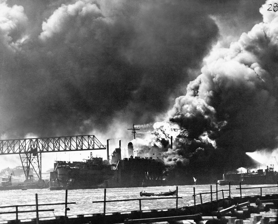 Description of . In this image provided by the U.S. Navy, general view of the burning and damaged ships of Pearl Harbor in Hawaii, during the Japanese aerial attack on Dec. 7, 1941. (AP Photo/U.S. Navy)