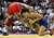 Henry Cejudo (blue) wrestles Stephan Abas (red) in the Freestyle 55kg division championship match during the USA Olympic trials for wrestling and judo on June 14, 2008 at the Thomas & Mack Center in Las Vegas, Neveda.  (Photo by Jonathan Ferrey/Getty Images)