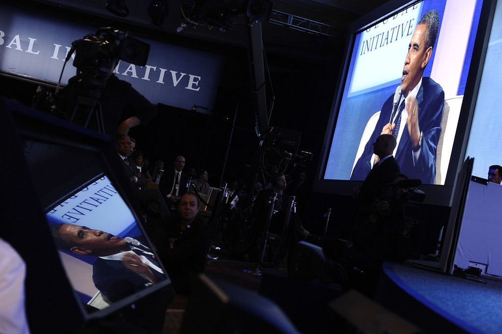 . US President Barack Obama is reflected on a monitor as he speaks during a conversation with former President Bill Clinton about the future of health care reform in America, and the benefits of expanding access to quality health care around the globe at Clinton Global Initiative in New York on September 24, 2013. JEWEL SAMAD/AFP/Getty Images