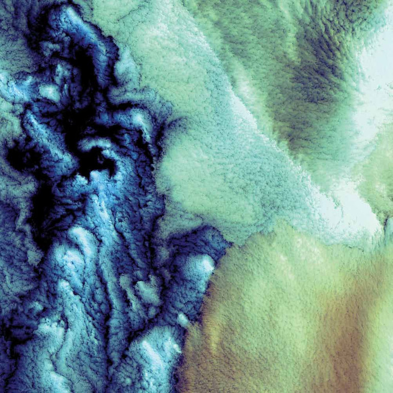Description of . Aleutian Clouds, Bering Sea Clouds hover over the waters off the western Aleutian Islands, where fog, heavy rains, and high winds are common. While the clouds in this 2000 Landsat 7 image are structured differently, all the clouds shown are low, marine stratocumulus clouds, which often produce drizzle. The color variations are probably due to differences in the temperature and in the size of the water droplets that make up the clouds. The Aleutian Islands are part of the Pacific Ring of Fire. The archipelago curves out 1,800 kilometers from southwestern Alaska towards Russia�s Kamchatka Peninsula.   NASA