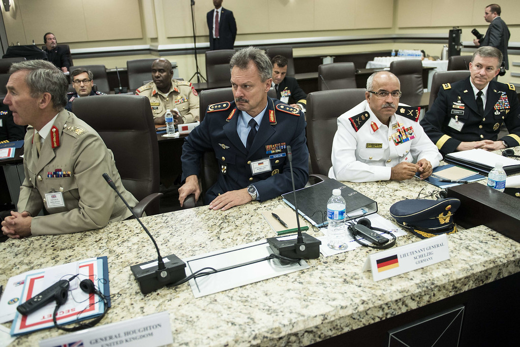 Description of . From left: Sir Nicholas Houghton, of the United Kingdom, Gen. Peter Schelzig, of Germany, Gen. Yousif, of Bahrain and US Lt. Gen. Garrett sit after a meeting with US President Barack Obama at Andrews Air Force Base October 14, 2014 in Maryland. Obama and Gen. Martin Dempsey, US Chairman of the Joint Chiefs of Staff, met with foreign military leaders from 21 countries to discus solutions for dealing with the Islamic State militant threat. BRENDAN SMIALOWSKI/AFP/Getty Images