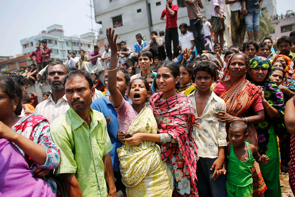 Description of . People mourn for their relatives, who are trapped inside the rubble of the collapsed Rana Plaza building, in Savar, 30 km (19 miles) outside Dhaka April 24, 2013.  REUTERS/Andrew Biraj