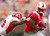Fresno State defensive back L.J. Jones (6) grabs SMU wide receiver Der'rikk Thompson (7) from behind and pushes him out of bounds in the second quarter of the Hawaii Bowl in an NCAA college football game Monday, Dec. 24, 2012, in Honolulu. (AP Photo/Eugene Tanner)