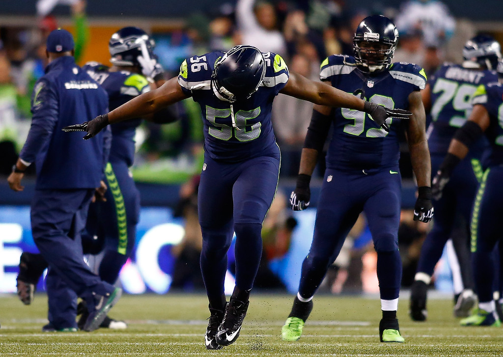 . Defensive end Cliff Avril #56 of the Seattle Seahawks celebrates in the fourth quarter while taking on the San Francisco 49ers during the 2014 NFC Championship at CenturyLink Field on January 19, 2014 in Seattle, Washington.  (Photo by Jonathan Ferrey/Getty Images)