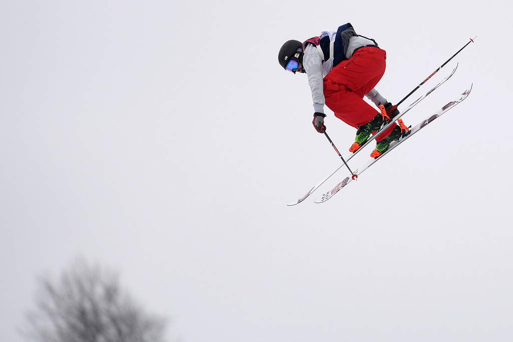 Description of . U.S.A. skier Devin Logan flies through the air during the women\'s ski slopestyle final. Sochi 2014 Winter Olympics on Tuesday, February 11, 2014. (Photo by AAron Ontiveroz/The Denver Post)