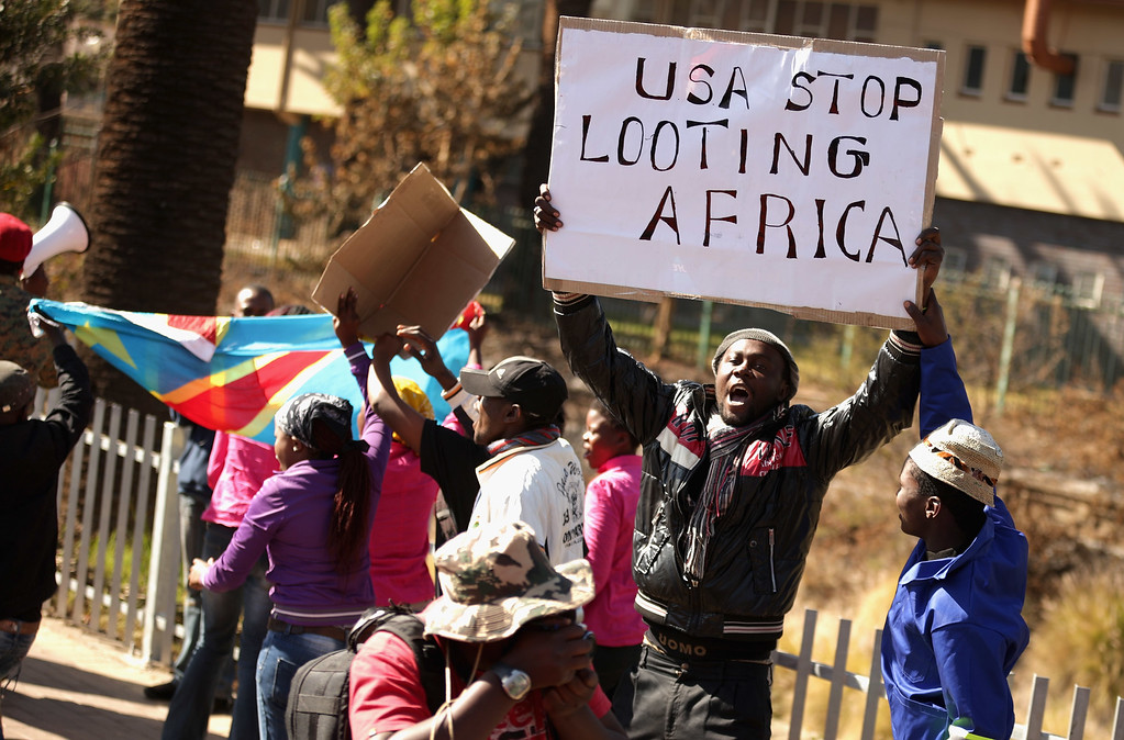 Description of . PRETORIA, SOUTH AFRICA - JUNE 28:  Anti-American demonstrators march through the streets while protesting against the official visit of U.S. President Barack Obama June 28, 2013 in Pretoria, South Africa. Organized by the Congress of South African Trade Unions, about 800 people marched through Pretoria to voice their opposition to Obama and U.S. policy in South Africa and around the world.  (Photo by Chip Somodevilla/Getty Images)