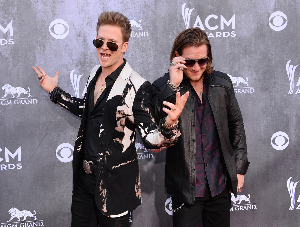 Description of . Brian Kelley, left, and Tyler Hubbard, of the musical group Florida Georgia Line, arrive at the 49th annual Academy of Country Music Awards at the MGM Grand Garden Arena on Sunday, April 6, 2014, in Las Vegas. (Photo by Al Powers/Powers Imagery/Invision/AP)