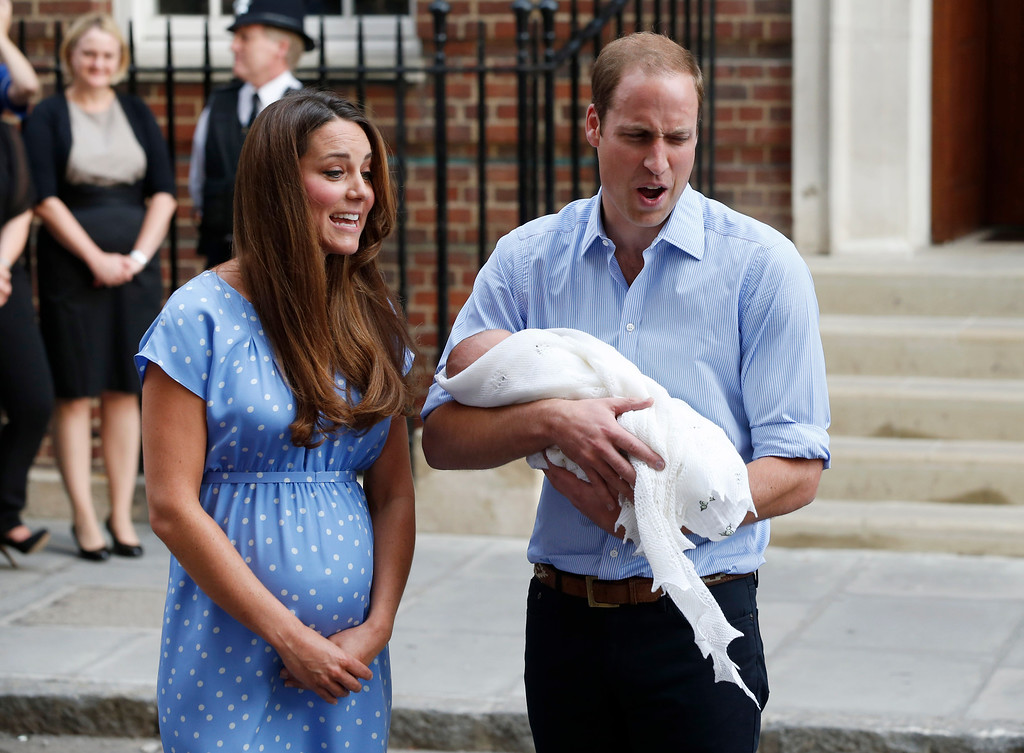 Description of . Britain\'s Prince William and Kate, Duchess of Cambridge hold the Prince of Cambridge, Tuesday July 23, 2013, as they pose for photographers outside St. Mary\'s Hospital exclusive Lindo Wing in London where the Duchess gave birth on Monday July 22. The Royal couple are expected to head to Londonís Kensington Palace from the hospital with their newly born son, the third in line to the British throne.  (AP Photo/Lefteris Pitarakis)