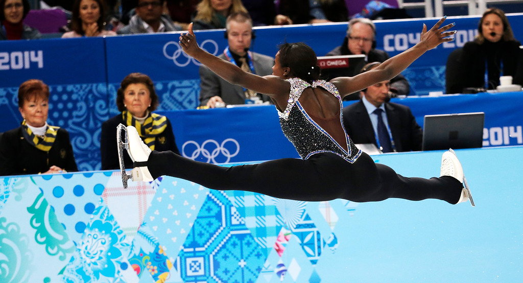 Description of . Mae Berenice Meite of France competes in the women's free skate figure skating finals at the Iceberg Skating Palace during the 2014 Winter Olympics, Thursday, Feb. 20, 2014, in Sochi, Russia. (AP Photo/Bernat Armangue)