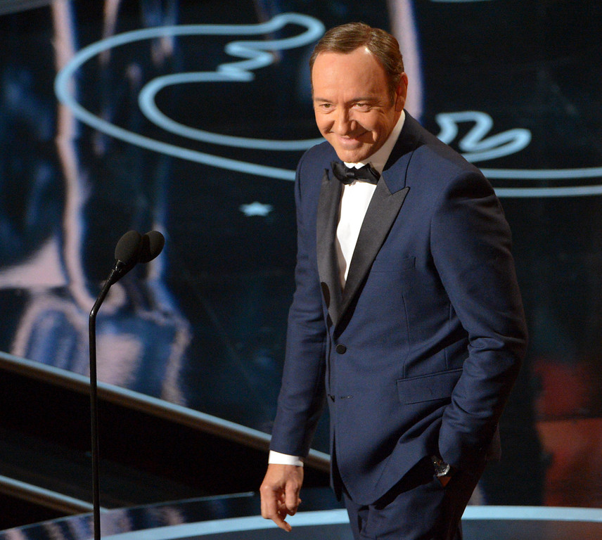 Description of . Kevin Spacey speaks during the Oscars at the Dolby Theatre on Sunday, March 2, 2014, in Los Angeles.  (Photo by John Shearer/Invision/AP)