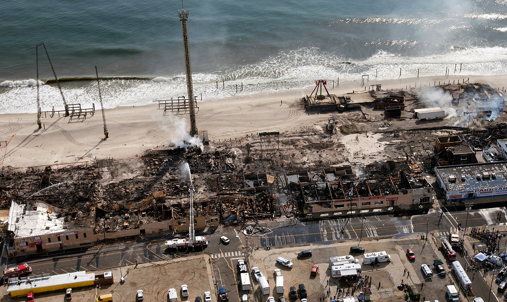 Description of . This aerial photo shows aftermath of a massive fire that burned a large portion of the Seaside Park boardwalk, Friday, Sept. 13, 2013, in Seaside Park, N.J.  (AP Photo/The Asbury Park Press, Bob Bielk)