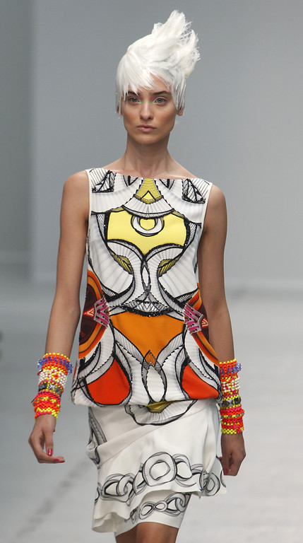 Description of . A model wears a creation as part of Indian fashion designer Manish Arora's ready-to-wear Spring-Summer 2014 fashion collection presented in Paris, Thursday, Sept.26, 2013. (AP Photo/Thibault Camus)