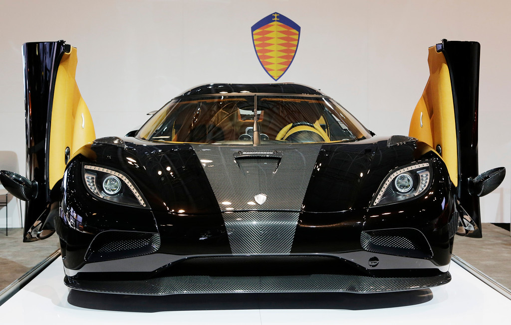 . The Koenigsegg Agera R is shown  with its doors open at the New York International Auto Show, Wednesday, April 16, 2014 in New York. (AP Photo/Mark Lennihan)