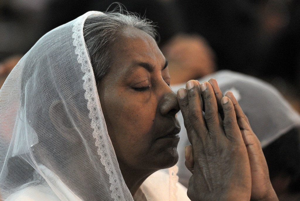 Description of . A Christian devotee prays during a Christmas mass in Colombo early on December 25, 2013. Christians account for some 6 per cent of Sri Lanka's 21 million population.    LAKRUWAN WANNIARACHCHI/AFP/Getty Images