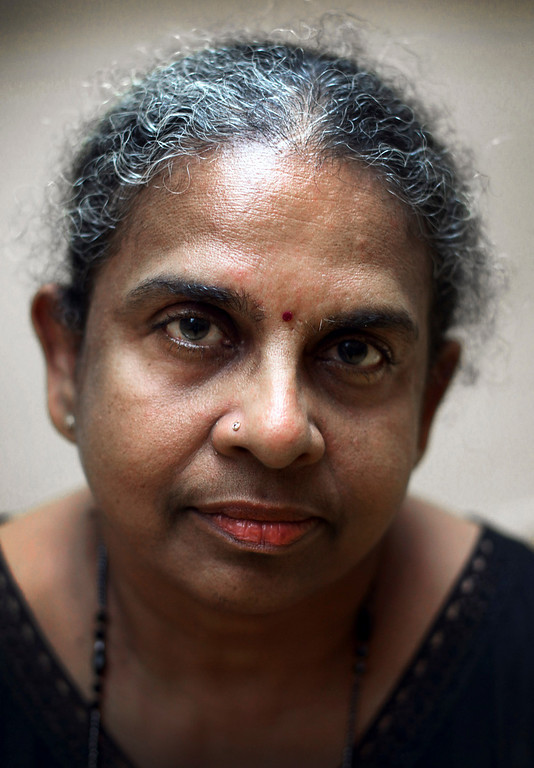 Description of . Retiree Padma Sagaram, 63, poses for a photo in Singapore on Monday, June 17, 2013. When asked: As you grow older, what are you most afraid of and what is the biggest problem facing the elderly in your country? Sagaram said,
