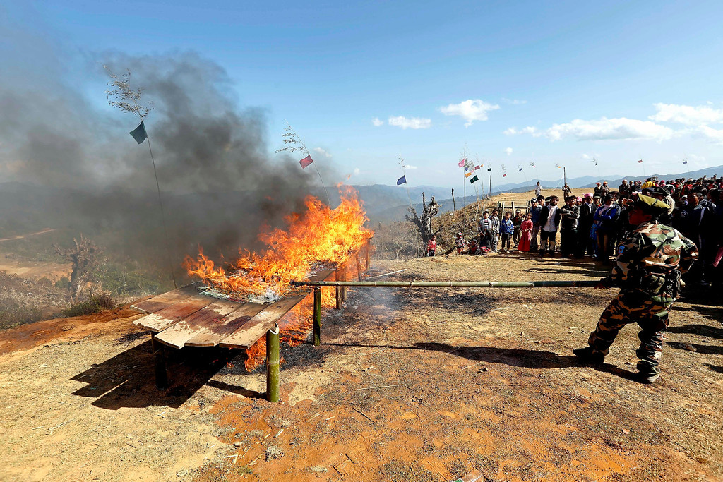 Description of . A soldier from the Ta-ang National Liberation Army (TNLA), one of the ethnic rebel groups, burning a pile of seized drugs in Homain village, Nansam Township, Northern Shan State, Myanmar on Jan. 24, 2014. Myanmar's opium production in 2013 was expected to reach 870 tons, a 26-per-cent increase year-on-year, for a 13-per-cent increase in cultivated area, the United Nations said. Last year, Myanmar produced an estimated 690 tons of opium, compared with 41 tons in Laos and 3 tons in Thailand, the three significant producers in South-East Asia. Myanmar was the world's largest source of opium and its derivative heroin in the early 1990s, but is now ranked second after Afghanistan. Myanmar's northern Shan State, home to several insurgencies including the Shan State Army and United Wa State Army, accounted for 92 per cent of opium poppy cultivation this year, with the remainder located in neighbouring Kachin State, where government troops and the Kachin Independence Army have been fighting since 2011, the report said.  EPA/NYEIN CHAN NAING