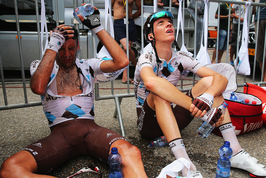 Description of . AX 3 DOMAINES, FRANCE - JULY 06:  6:  Jean-Christophe Peraud (l) of France and AG2R La Mondiale and team mate Romain Bardet recover after at the end of stage eight of the 2013 Tour de France, a 195KM road stage from Castres to Ax 3 Domaines, on July 6, 2013 in Ax 3 Domaines, France.  (Photo by Bryn Lennon/Getty Images)