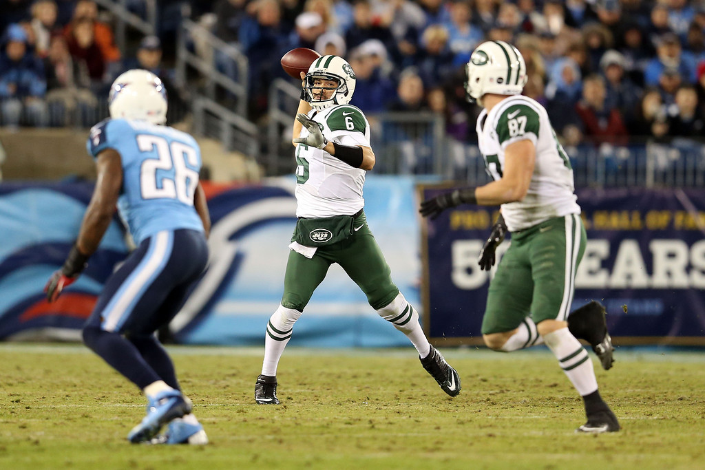 Description of . NASHVILLE, TN - DECEMBER 17:  Quarterback Mark Sanchez #6 of the New York Jets throws the ball against the Tennessee Titans at LP Field on December 17, 2012 in Nashville, Tennessee.  (Photo by Andy Lyons/Getty Images)