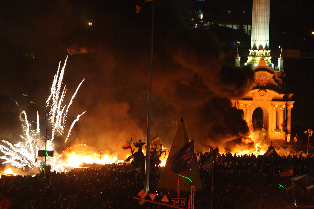 Description of . Fireworks explode as Ukrainians gather on the Independence Square during continuing protest in Kiev, Ukraine, 18 February 2014.   EPA/IGOR KOVALENKO