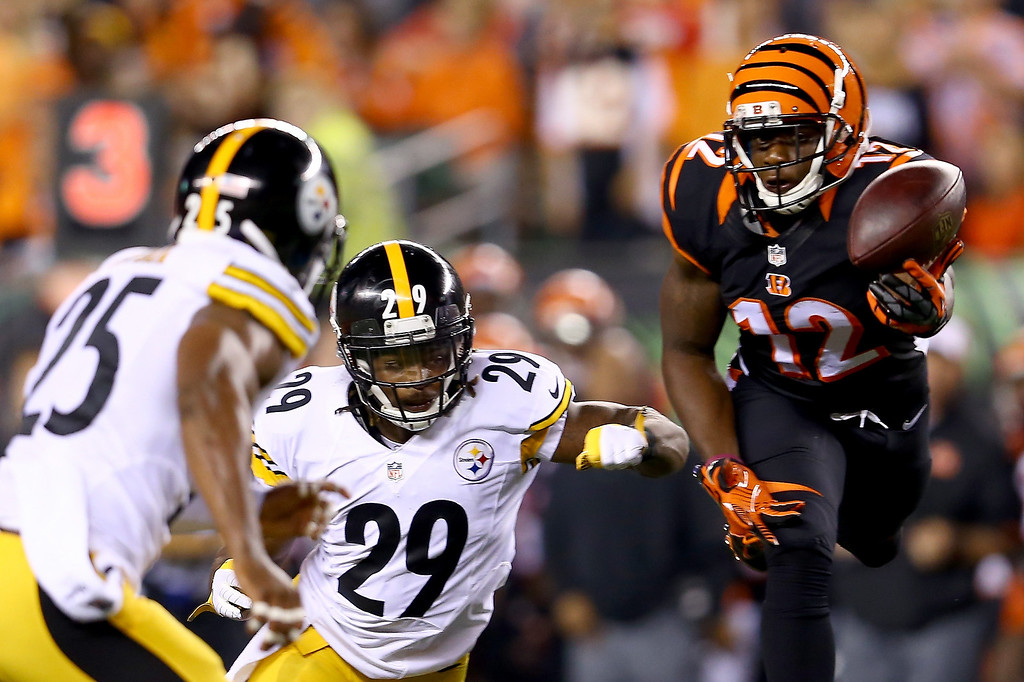Description of . Wide receiver Mohamed Sanu #12 of the Cincinnati Bengals is unable to make a catch against strong safety Shamarko Thomas #29 and free safety Ryan Clark #25 of the Pittsburgh Steelers in the second quarter at Paul Brown Stadium on September 16, 2013 in Cincinnati, Ohio.  (Photo by Andy Lyons/Getty Images)