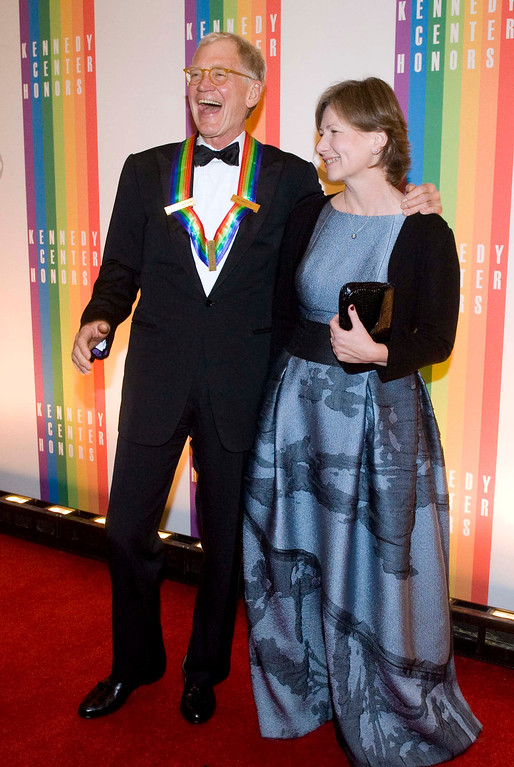 Description of . 2012 Kennedy Center Honoree David Letterman, and his wife, Regina, arrive at the Kennedy Center for the Performing Arts for the 2012 Kennedy Center Honors Performance and Gala Sunday, Dec. 2, 2012 at the State Department in Washington. (AP Photo/Kevin Wolf)
