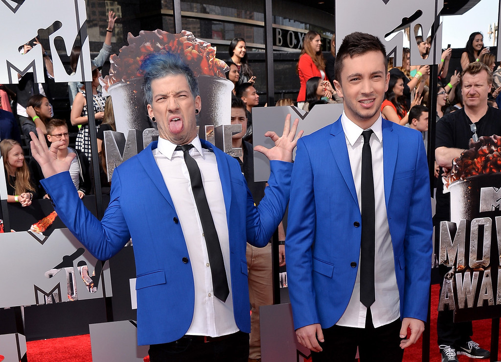 Description of . Musicians Josh Dun (L) and Tyler Joseph of Twenty One Pilots attend the 2014 MTV Movie Awards at Nokia Theatre L.A. Live on April 13, 2014 in Los Angeles, California.  (Photo by Michael Buckner/Getty Images)