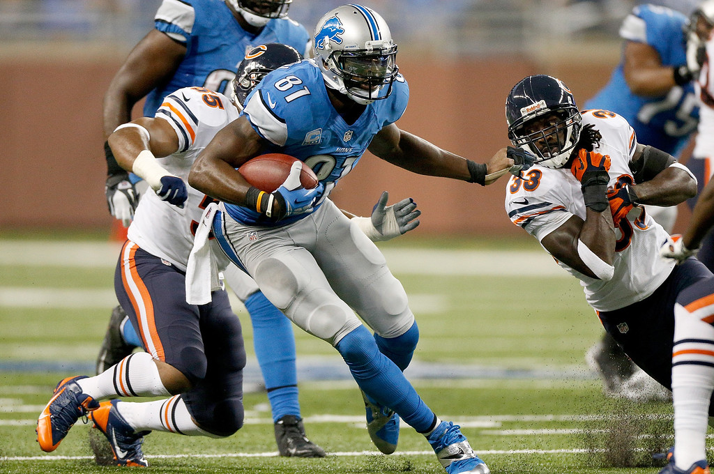 Description of . DETROIT, MI - SEPTEMBER 29: Calvin Johnson #81 of the Detroit Lions stiff arms Charles Tillman #33 of the Chicago Bears at Ford Field on September 29, 2013 in Detroit, Michigan. (Photo by Gregory Shamus/Getty Images)