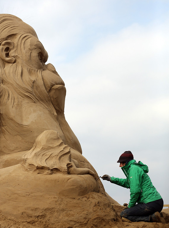 . Sand sculptor Helena Bangert, from Holland works on a sand sculpture of King Kong as pieces are prepared as part of this year�s Hollywood themed annual Weston-super-Mare Sand Sculpture festival on March 26, 2013 in Weston-Super-Mare, England. Due to open on Good Friday, currently twenty award winning sand sculptors from across the globe are working to create sand sculptures including Harry Potter, Marilyn Monroe and characters from the Star Wars films as part of the town\'s very own movie themed festival on the beach.   (Photo by Matt Cardy/Getty Images)