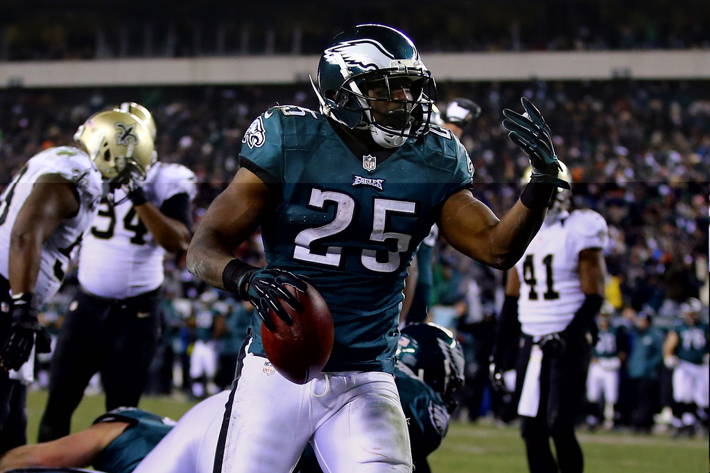 Description of . PHILADELPHIA, PA - JANUARY 04:  LeSean McCoy #25 of the Philadelphia Eagles celebrates after scoring a 1 yard touchdown in the third quarter against the New Orleans Saints during their NFC Wild Card Playoff game at Lincoln Financial Field on January 4, 2014 in Philadelphia, Pennsylvania.  (Photo by Al Bello/Getty Images)