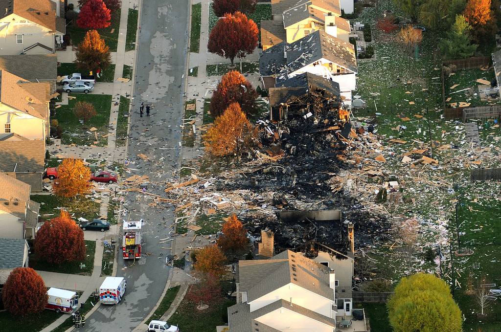 Description of . In this Nov. 11, 2012 file aerial photo, the two homes that were leveled and the numerous neighboring homes that were damaged from a massive explosion that sparked a huge fire and killed two people are shown in Indianapolis.  Nearly three dozen homes were damaged or destroyed, and seven people were taken to a hospital with injuries. The powerful nighttime blast shattered windows, crumpled walls and could be felt at least three miles away. Authorities have said they believe the explosion was intentional and caused by natural gas but have released no other details.  (AP Photo/The Indianapolis Star, Matt Kryger, File)  NO SALES
